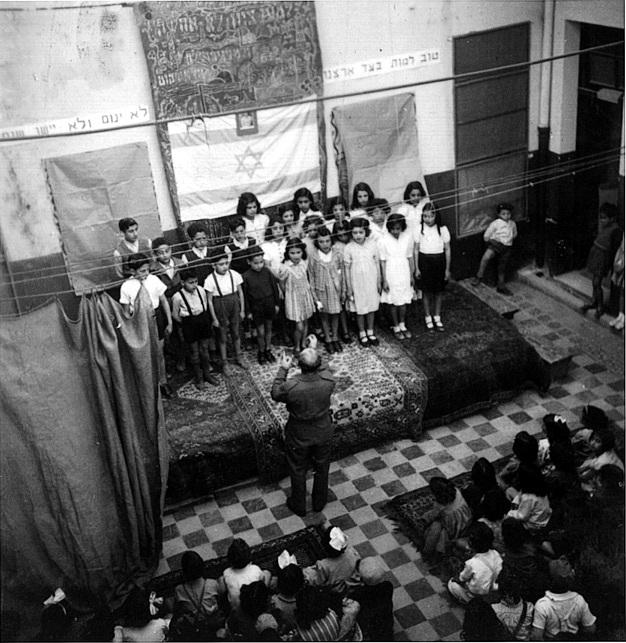 Students of the Hebrew School of Benghazi during a singing lesson, Libya, 1943