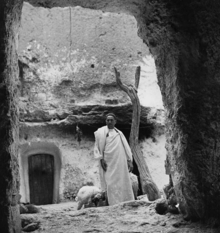 A tenant with sheep in the yard of the house, Gharian, Libya, 1947.