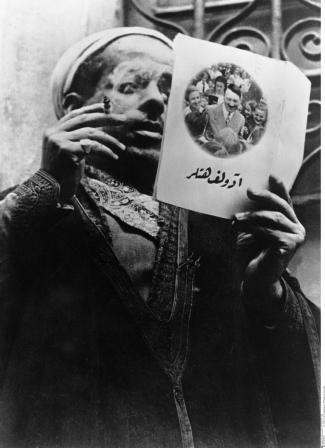 A Tunisian looking at propaganda pamphlet in German