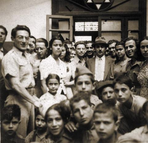 """<a href=""""/he/2910"""">ביקור של משה שרת בבית הספר העברי בבנגאזי, לוב 1944</a>"""