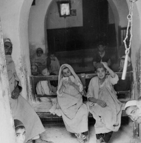 """<a href=""""/en/2899"""">A Talmud Torah class in the new synagogue of Gharian, the Jewish community of cave dwellers in Gharian, Libya, 1947</a>"""
